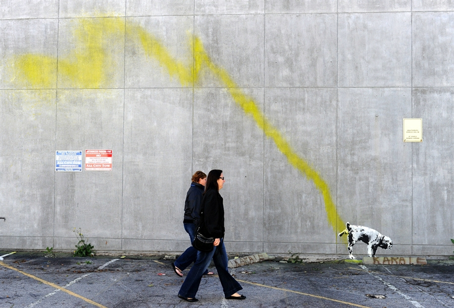 Banksy Dog lifting its leg